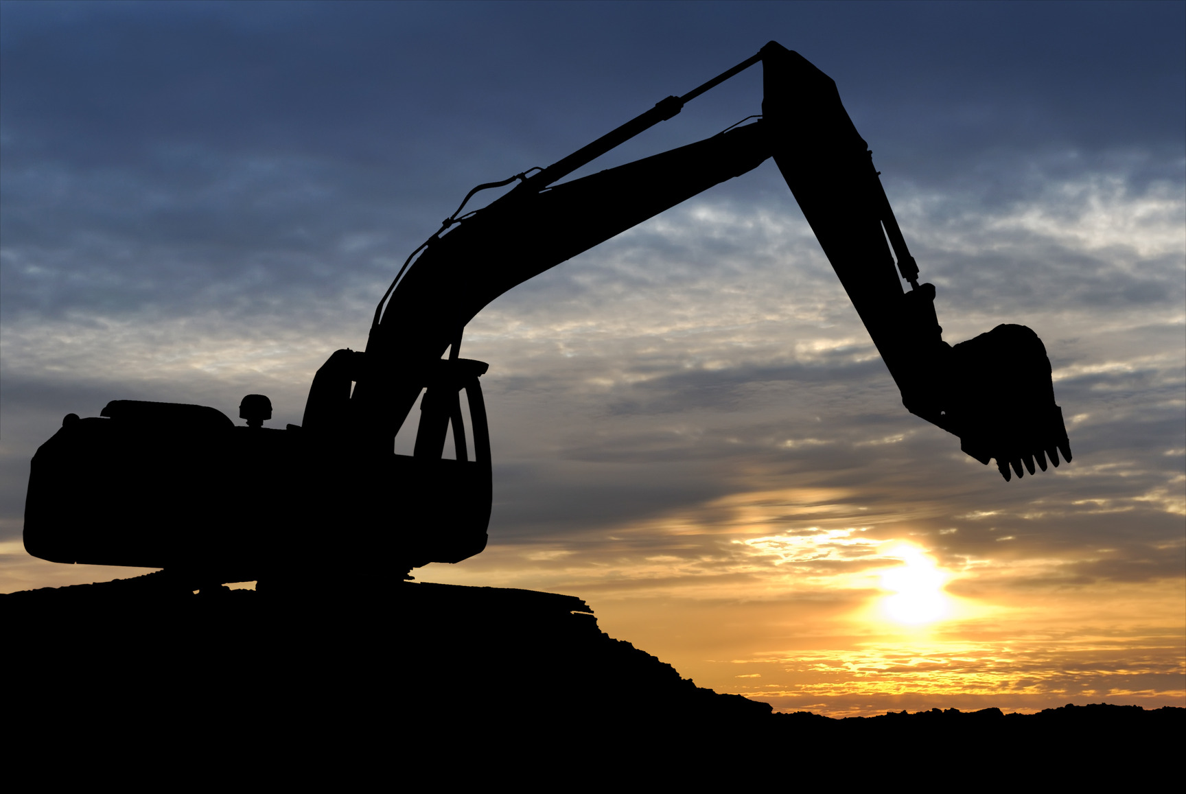 photodune-1304277-loader-excavator-over-sunset-m